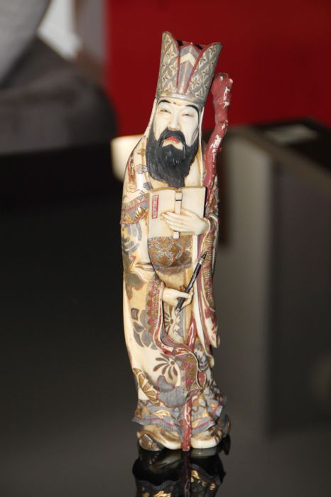 Antique signed ivory carved polychromed okimono statue old bearded sage man holding a book - China / Japan - ca. 1930