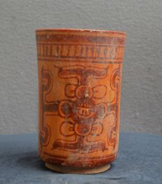 Pre Colombian earthenware cylinder vase with symbols as decor