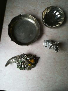 Silver laminate cow figurine, silver laminate cornucopia, silver plaid candy bowl and sugared almond bowl.