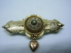 An old Victorian (19th century) silver brooch with a small pearl