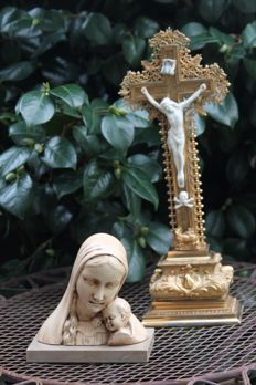 old holy statue of Mother Mary with child and completely gold patinated, vintage cross that is 35 x 20 cm