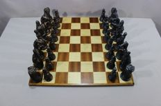 The Original Great Figural Chess Set; Carved Figures