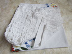 Linen tablecloth with embroidered pattern.