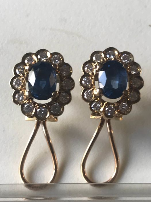 Short earrings with entourage of diamonds and sapphires