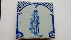 Gate tile with lady