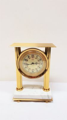 French brass Vedette clock on a marble base