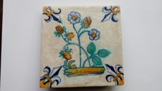 Tile with a strawberry plant