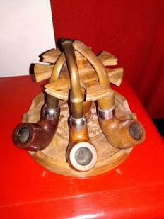 A collection of 3 Peterson pipes, made in Ireland, with briar pipe stand