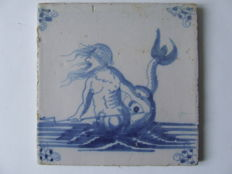 Sea creature tile with Neptune and trident