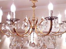 Vintage chandelier with bronze body and Bohemian crystal glasses. From the 1920s. Diameter: 75 cm