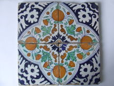 Four coloured ornament tiles in octagon