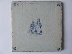 Antique tile with mother and child