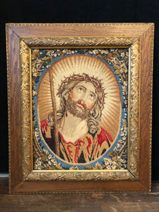 Embroidery of religious icon in wonderful frame