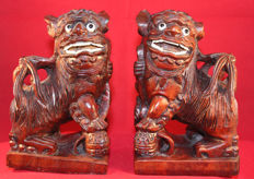 A pair of wooden sculpted temple lions - China - Second half of 20th century
