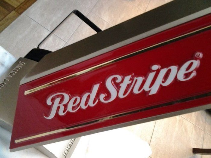 Unique complete Jamaican beer tap faucet.  Beer brand:  RED STRIPE (Europe).