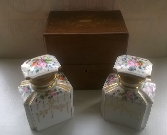 A pair of beautiful antique porcelain perfume scent bottles in original wooden inlaid box