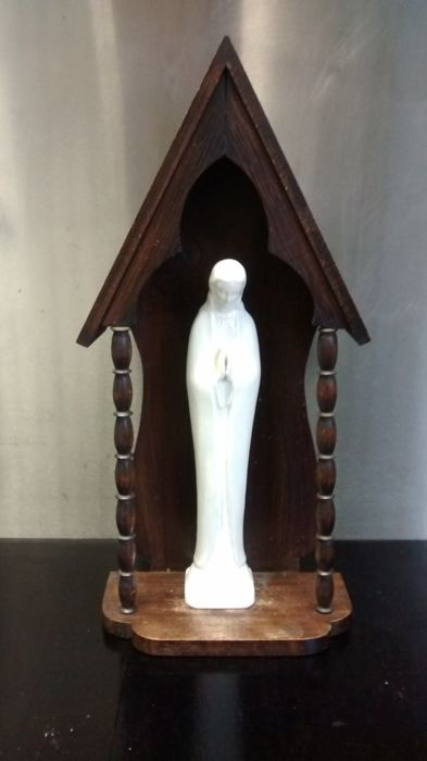 Antique vintage wooden chapel with Mary Madonna figurine