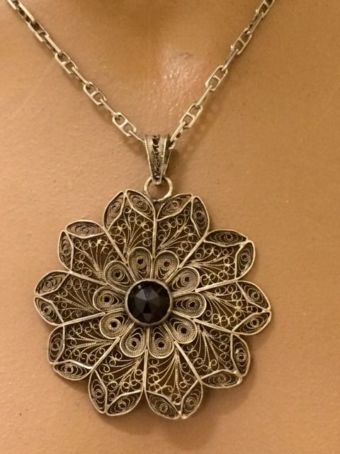 Antique silver filigree pendant with rose cut garnet on a necklace antique silver filigree pendant with rose cut garnet on a necklace south netherlands 1930 aloadofball Image collections