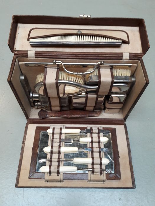 Silver plated vanity travel set in a simulated crocodile skin leather case - 1920s