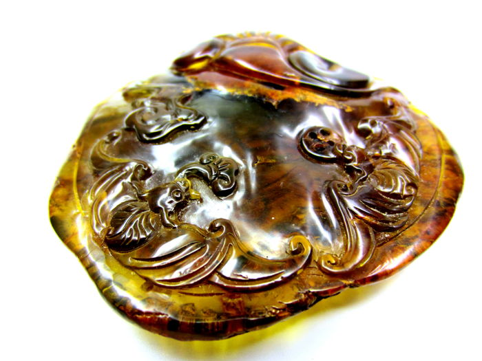 Dominica blue amber, carving - 8.2 x 7.8 cm - 48.9 gm