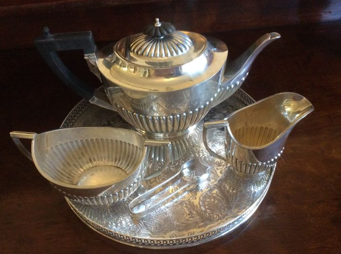 Ornate silver plated three-piece tea set with Semi Embossed fluted design made in England Sheffield,sugar tong and round serving tray