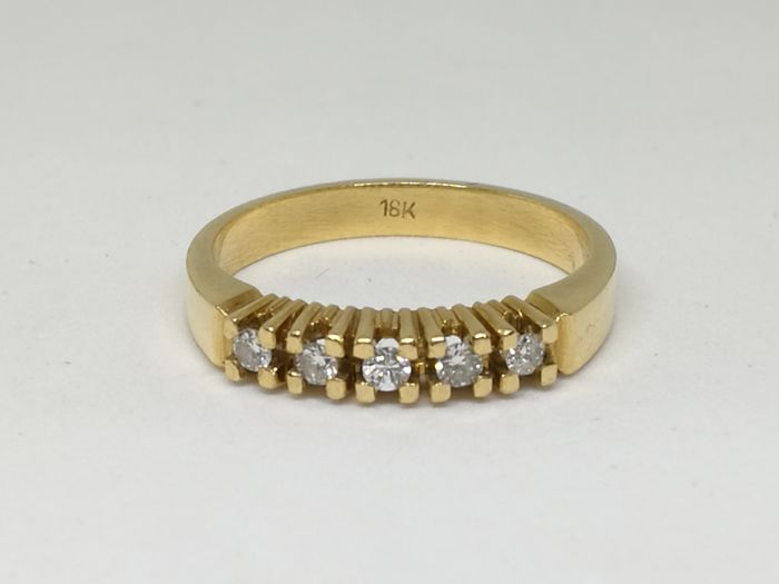 Ring in 18 kt (750) yellow  gold - Diamonds of 0.25 ct - Size e15