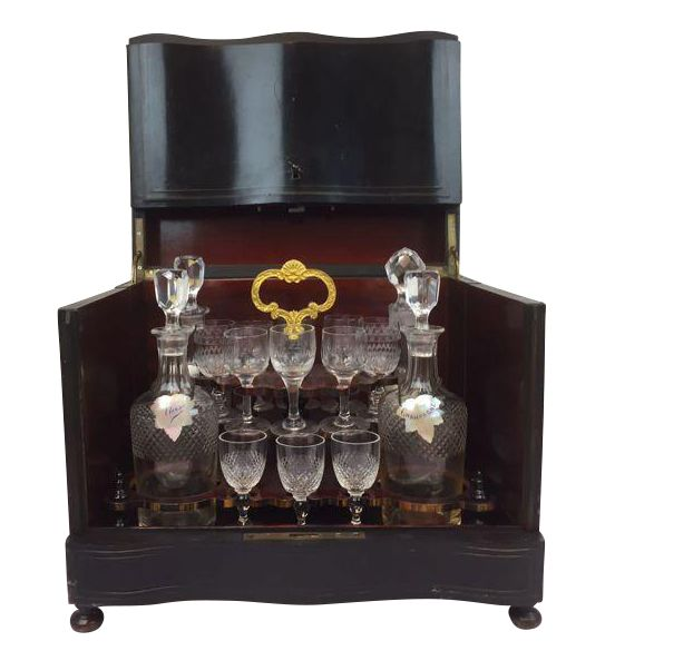 A Napoleon III bois noirci liqueur cellar with brass inlay - original interior with 4 decanters and 15 glasses - France - circa 1900