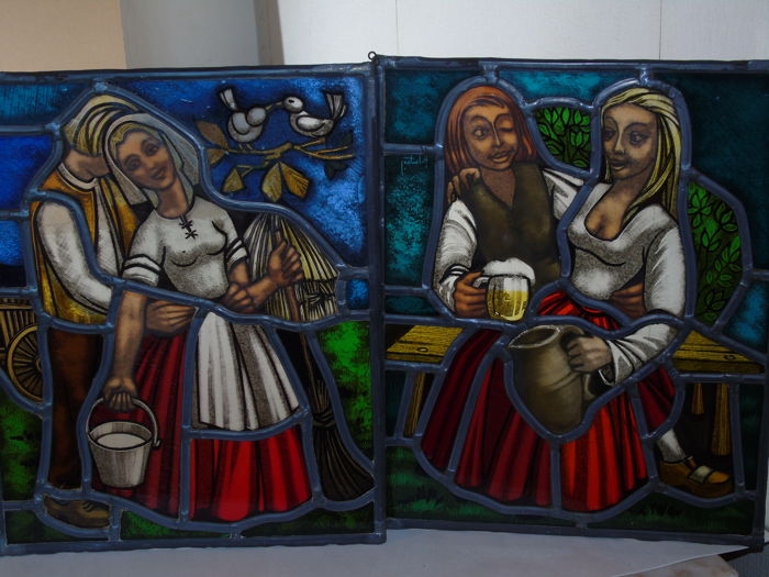 Two hand-painted stained glass windows - both with depiction of a drinking binge in Breughel-style - mid-20th century