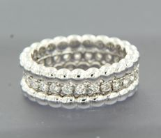 14 kt white gold full eternity ring set with 27 brilliant cut diamonds, approx. 0.85 carat in total and two 18 kt white gold stacking rings, ring size 17 (53)