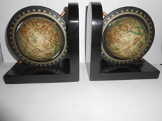 Old wooden bookends with globe