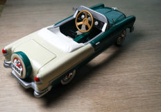 Large diecast metal 23 cm lenght open 1955 Belair pedal car with picknick case, showroom collection.