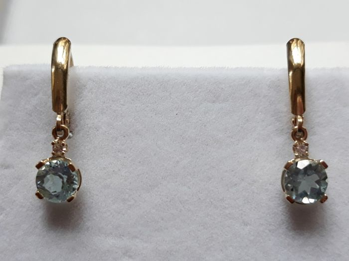 Gold earrings with 2.10 ct topaz & diamonds