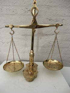 Beautiful copper balancing scales with embedded weights