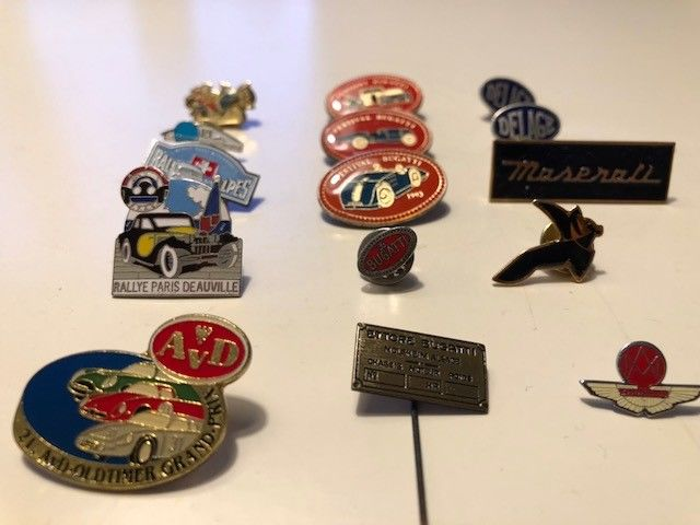 Various pins of car brands and rallies