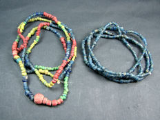 2 strings of Indo - Pacific trade beads circa 500 to 1900 A.D.
