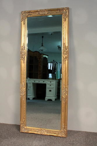 Beautiful, large baroque mirror in a wooden frame, covered with gold leaf flakes - 132 x 52 cm