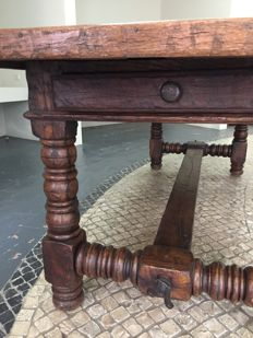 Beautiful solid wood table. Brown, with two drawers.