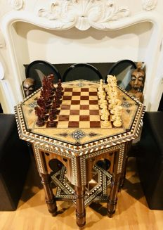 Alhambra Chess table made of inlaid wood and bone Pieces of rosewood