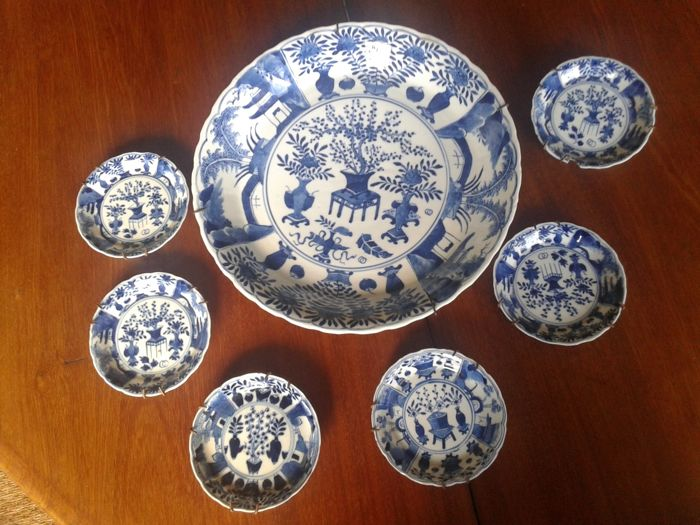 Blue and white plate with matching small plates - China - 19th century