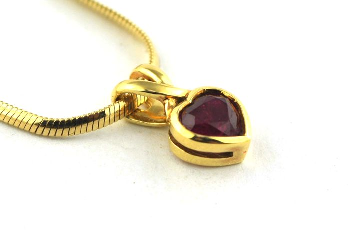 Heart shaped ruby 070ct set on 18k italian made yellow gold heart shaped ruby 070ct set on 18k italian made aloadofball Image collections