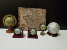 Globes and image on wood