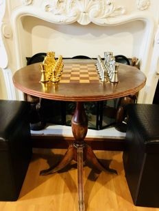 Chess table made of walnut wood and with metal pieces