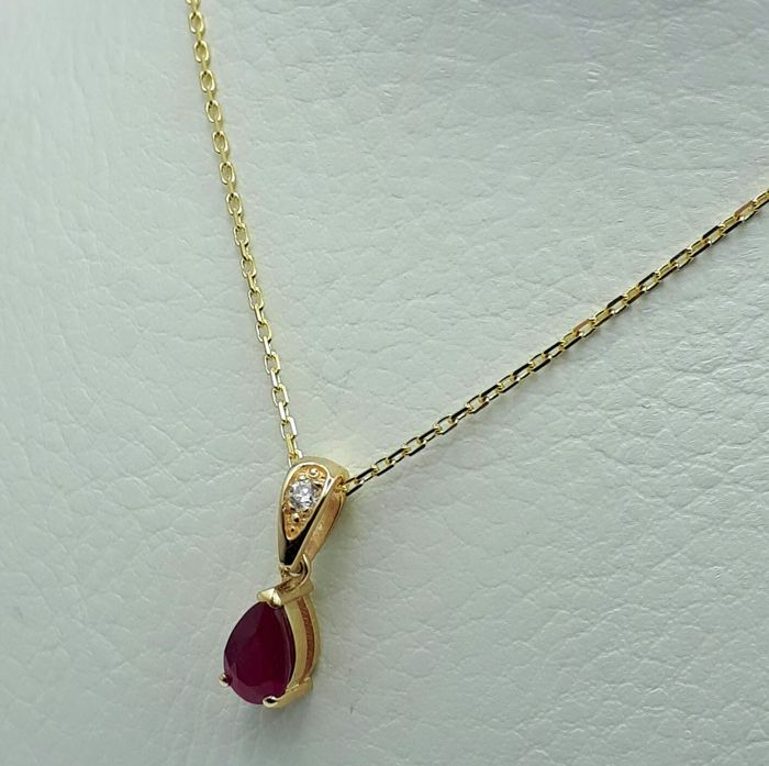 14 ct yellow gold chain ruby pendant with diamond ruby 050 ct 14 ct yellow gold chain ruby pendant with diamond ruby 050 ct diam002 ct length 50 cm total weight 214g aloadofball Images