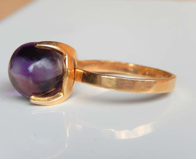 Ring with 5 interchangeable semi-precious stones in 18 kt gold