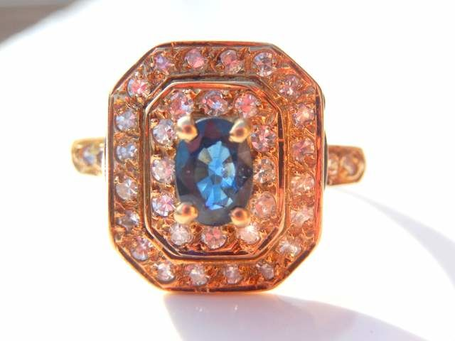 Octagonal ring total 1 ct blue sapphire and 36 diamonds in 18 kt yellow gold