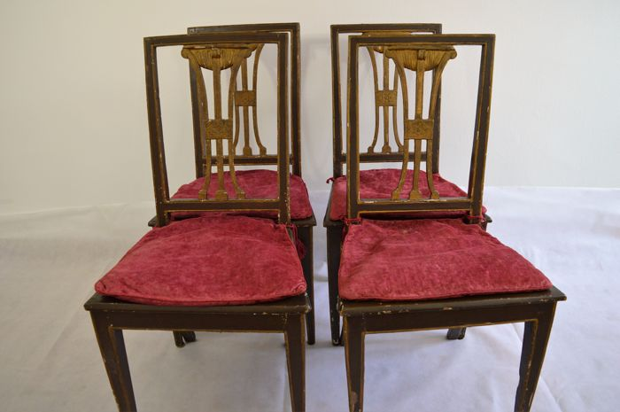 Set of four chairs painted and gilded in neoclassical style, Italy, 19th century