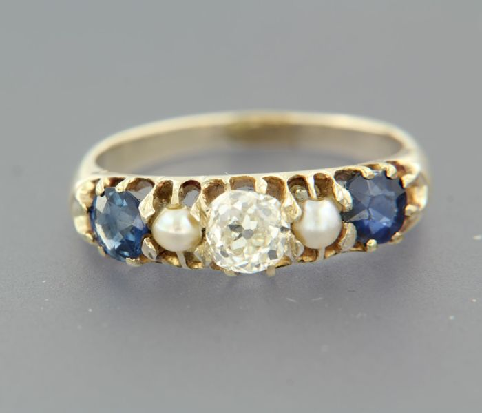 Yellow gold Victorian ring with cultured pearls and Bolshevik cut sapphire and diamond, set in a row.