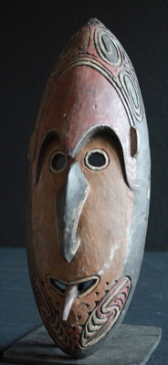 Individually carved house mask from Sepik