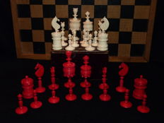 Antique English staunton pattern ivory chess set with original box and board.
