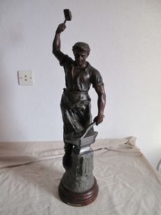 Large sculpture in spelter, representing a blacksmith at work - signed J. Becox - France - early 20th century
